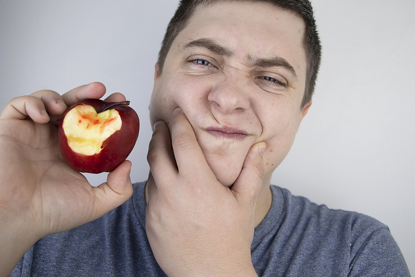 A Man Bit An Apple And Blood Came Out Of His Gums. Gum Bleeding,
